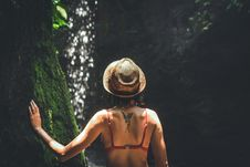 Free Young Woman Tourist With Straw Hat Deep In The Rainforest With Waterfall Background. Bali Island. Stock Image - 162501851