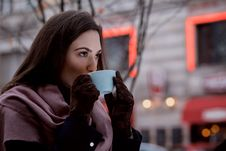 Free A Woman Drinking Coffee Outdoors Stock Images - 162501864