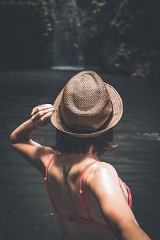 Free Rear View Of Young Woman Tourist With Straw Hat And Red Swimsuit In The Deep Jungle. Real Adventure Concept. Bali Island. Royalty Free Stock Image - 162501866