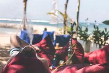 Free Man Smoking Hookah On A Beach Side Restaurant Next To The Sea. Shisha Smoking. Bali Island. Royalty Free Stock Photo - 162502095