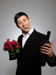 Free Young Man Holding Rose Flower And Vine Bottle Stock Images - 16261844