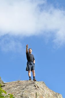 A Young Man Stands On A Cliff Top Royalty Free Stock Photos