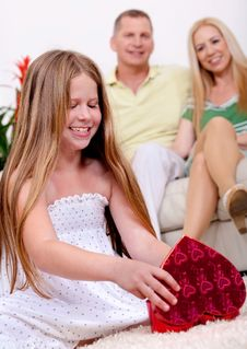 Free Happy Young Girl Opening A Gift Box Stock Photo - 16264240