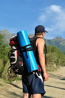 Tourist With A Large Backpack Is A High Mountain, Stock Photo