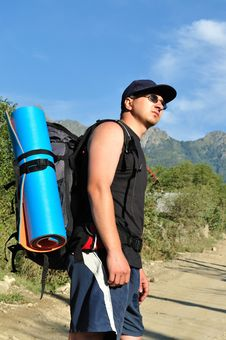 Free Tourist With A Large Backpack Is A High Mountain, Stock Image - 16267521
