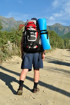 Free Tourist With A Large Backpack Is A High Mountain, Royalty Free Stock Photos - 16267568