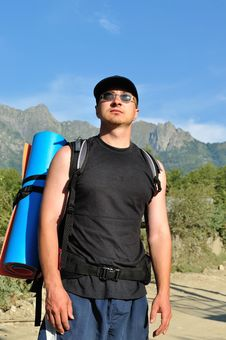 Free Tourist With A Large Backpack Is A High Mountain, Stock Photography - 16267732