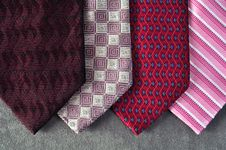 Free Four Ties In Red Tones With A Gray Background. Royalty Free Stock Photos - 16272588