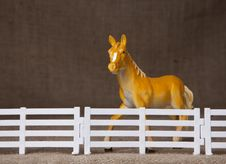 Free Toy Horse Behind Fence Stock Photography - 16273002