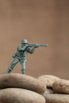 Free Toy Soldier On The Rocks Royalty Free Stock Image - 16273296