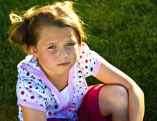 Free Beautiful Young Girl Unhappy On The Grass Royalty Free Stock Photography - 16274177