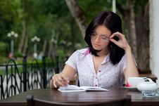 Free Girl With Notepad In Cafe Stock Images - 16274624
