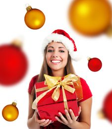 Young Girl With A Xmas Gift And Spheres Stock Photography