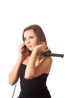 Free A Girl With Revolver Speak By Phone Stock Photo - 16274730
