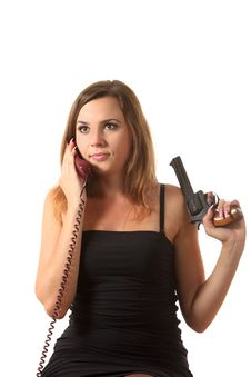 Free A Girl With Revolver Speak By Phone Royalty Free Stock Photography - 16274737