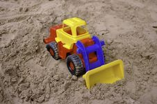 Free Plastic Toy Tractor On The Sand Stock Images - 16275044