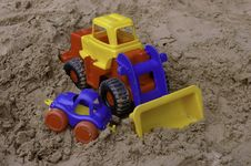 Free Plastic Toy Tractor On The Sand With The Car Royalty Free Stock Photo - 16275075