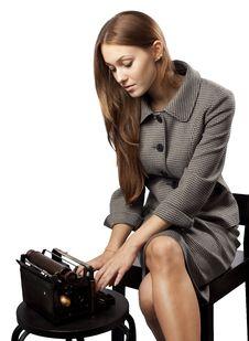 Free Girl Is Typing At The Old Black Typewriter Stock Image - 16279801