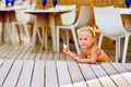 Free Cute Little Girl Sits Have A Snack Outdoor Stock Photography - 16282602