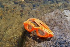 Free Glasses For Swimming On A Stone Royalty Free Stock Images - 16281409