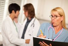 Free Alarmed Medical Woman Witnesses Colleagues Romance Stock Photo - 16284240