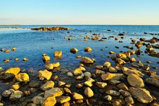Mediterranean Sea With Rocks At Sunset Stock Images