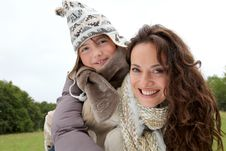 Free Woman Giving Piggyback Ride To Child Royalty Free Stock Image - 16289596