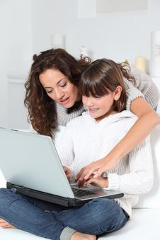 Free Woman And Girl In Front Of Computer Royalty Free Stock Photos - 16289618