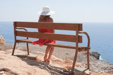 Free Woman Sitting On A Bench Stock Photo - 16290680