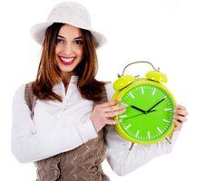 Free Stylish Lady Holding Alarm Clock Stock Image - 16291281