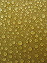 Free Rain Drops At Yellow Surface. Stock Photography - 1636552