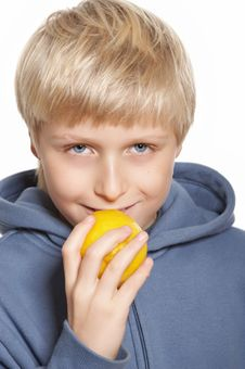 Eleven Years Old Boy With Lemon Royalty Free Stock Images