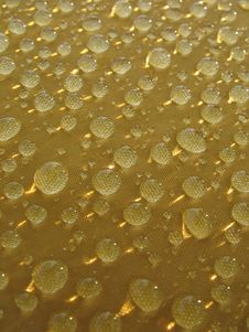 Rain Drops At Yellow Surface With  Sunny Glare Royalty Free Stock Photography