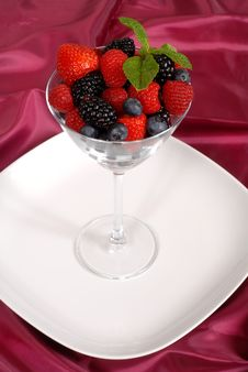Fresh Berries Topped With Mint In A Martini Glass Royalty Free Stock Image