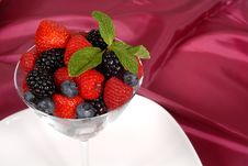 Fresh Berries Topped With Mint In A Martini Glass Resting On A W Stock Photography