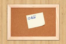 Free Corkboard With Empty Yellow Notes On Maple Wood Stock Photo - 16302440