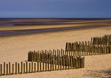 Free Wooden Breakwaters On The Beach Royalty Free Stock Photography - 16304587