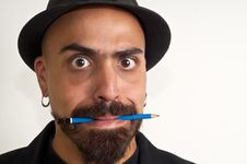 Man With A Pencil And A Hat With Funny Expression Stock Photos