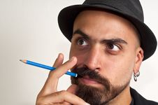 Man With A Pencil And A Hat With Funny Expression Royalty Free Stock Image