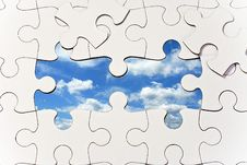 Free Puzzle With Missing Pieces Revealing Blue Sky Stock Photography - 16308632