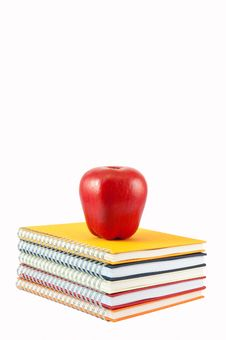 Apple Placed On Stack Of Note Book Stock Image