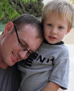 Free Father Holding His Son Stock Images - 16317574