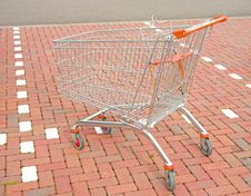 Free Shopping Trolley In Parking Bay. Stock Photos - 16310993