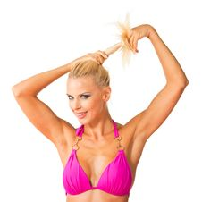 Beautiful Blonde Twirling Her Ponytail Stock Photo