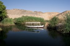 A Fisherman S Boat On A Lake In The Dessert Royalty Free Stock Photo