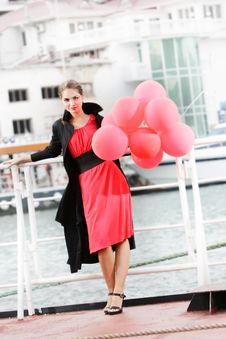Attractive Woman With Red Balloons Stock Photo