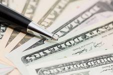 Dollar Banknotes And Pen Stock Photos