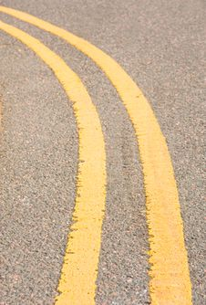 Double Yellow Lines On A Curve In The Road. Royalty Free Stock Photos