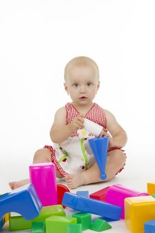 Dinky Little Girl And Her Toys Royalty Free Stock Images