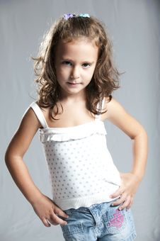 Young Cute Girl Against Grey Background Royalty Free Stock Images